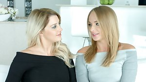 Two sex-appeal blue eyed blondes give an interview