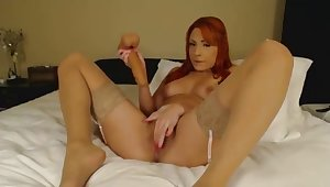 redhead spoil pleasures a dildo with pussy and mouth