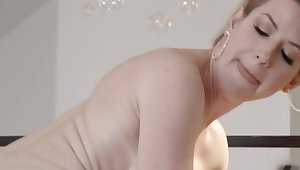 Big-boobied MILF with short hair checks bald guy's cock in action